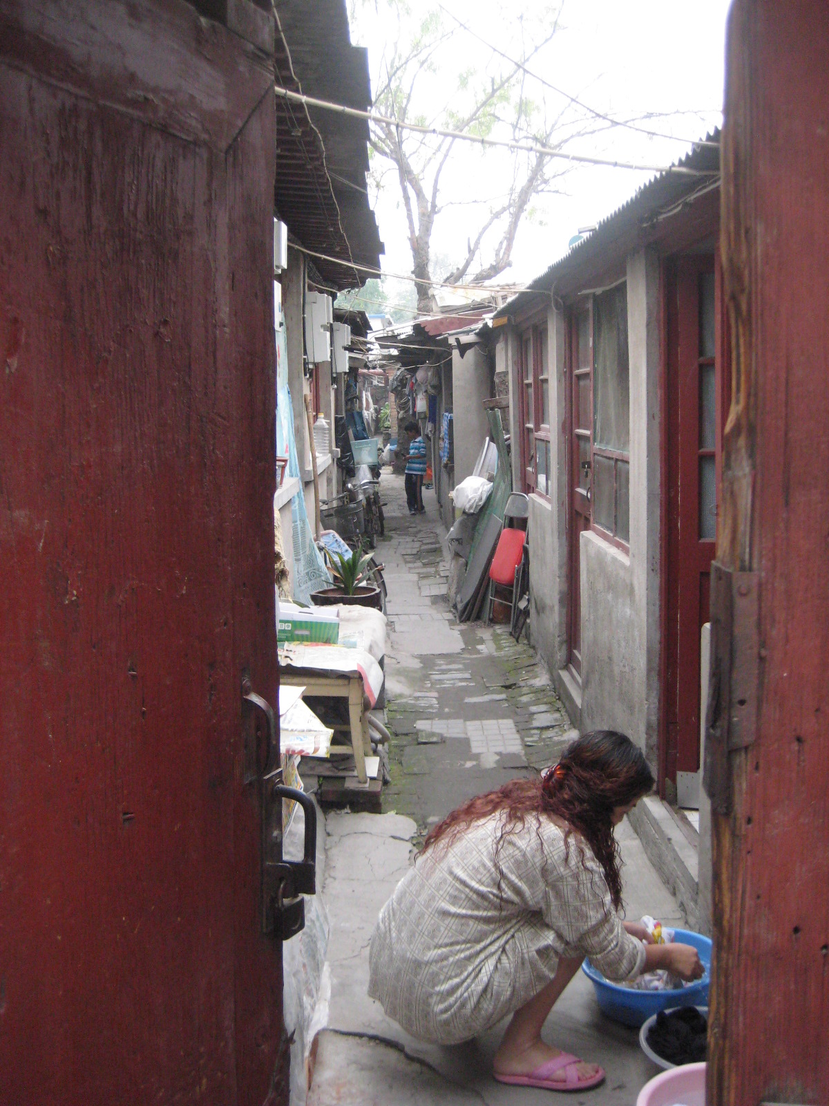 An_Unguarded_Moment_in_a_Traditional_Hutong_Alley.JPG